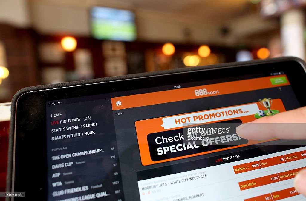 The 888 Holdings Plc sports betting app sits on a tablet device in this arranged photograph taken in London, U.K., on Friday, July, 17, 2015. 888 Holdings Plc agreed to buy Bwin.party Digital Entertainment Plc for 898.3 million-pounds ($1.4 billion) in cash and shares, winning over the online gaming company that's been at the center of a takeover battle. Photographer: Chris Ratcliffe/Bloomberg via Getty Images