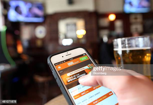 The 888 Holdings Plc sports betting app sits on an Apple Inc iPhone 6 in this arranged photograph taken in London UK on Friday July 2015 888 Holdings...