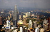 The 88story Petronas Twin Towers the tallest buildings in the world soar March 12 2002 in downtown Kuala Lumpur Malaysia The gleaming architectural...