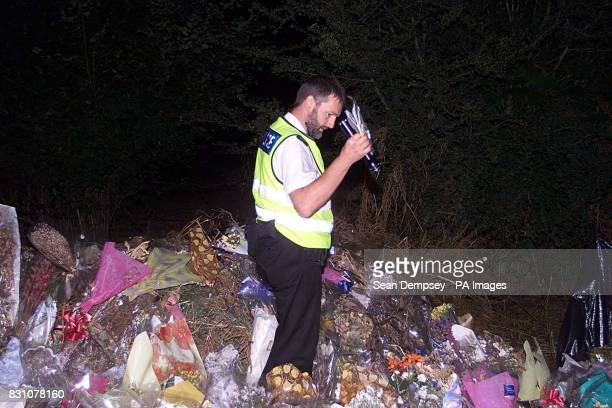The A29 road side in Pulborough West Sussex where tributes for the eight year old murdered school girl Sarah Payne are placed Police officer's are...