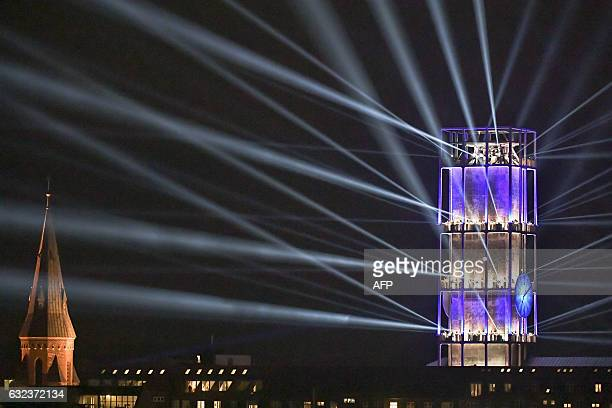 The Aarhus Cathedral and Aarhus City Hall are illuminated during festivities to celebrate Aarhus becoming a European Capital of Culture 2017 on...