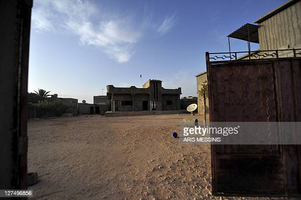 The abandoned house of Libyan regime supporters is pictured in Tawarga on September 25 2011 The people of Tawarga who are mostly blackskinned Libyans...
