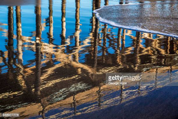 The abandoned pier at Gaviota Beach is reflected in the sand on December 28 in Gaviota State Park California Because of its close proximity to the...