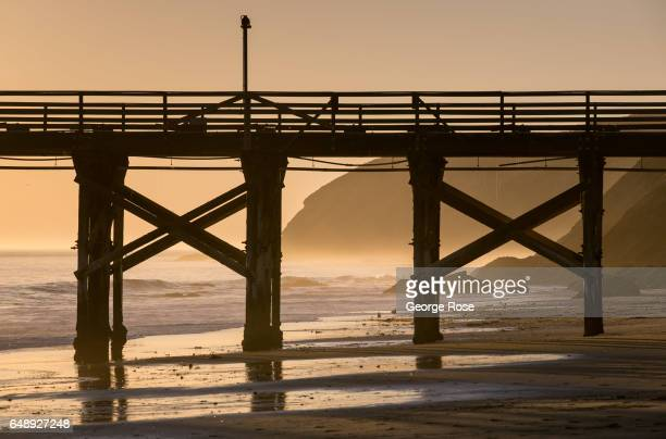 The abandoned pier is silhouetted against a setting sun on December 28 in Gaviota State Park California Because of its close proximity to the...