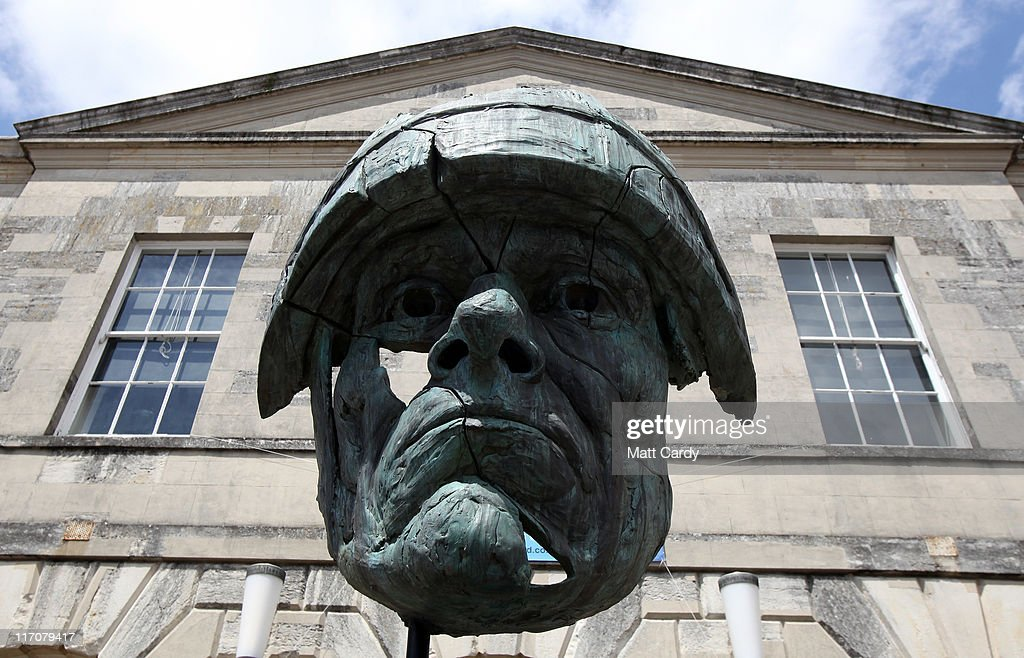 The Abandoned Soldier, a commemorative sculpture created to honour those who have fought for Britain greets visitors outside Exeter Castle on June 21, 2011 in Exeter, England. The paintings are among artworks produced by former and current servicemen and women currently being exhibited at Exeter Castle. The free exhibition, Entrance to War Art, aims to foster understanding between Post Traumatic Stress Disorder (PTSD) sufferers and the wider community and runs until Sunday.
