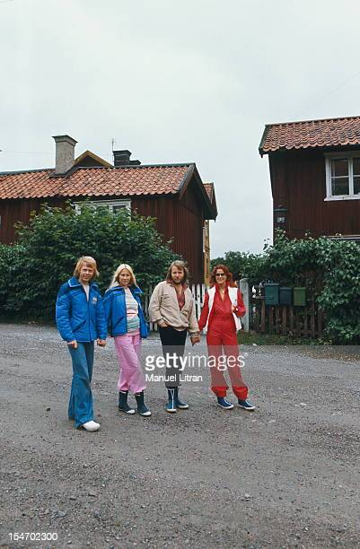 The ABBA posing in a street of a village with AnniFrid Lyngstad and her husband Benny Andersson Agnetha Faltskog and Bjorn Ulvaeus her husband