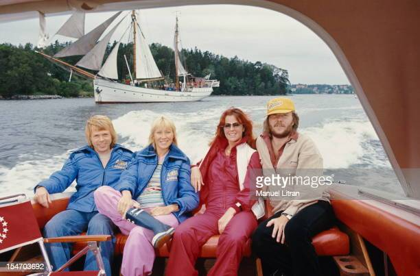 The ABBA posing in the back of a boat with from left to right Bjorn Ulvaeus and his wife Agnetha Faltskog AnniFrid Lyngstad and her husband Benny...