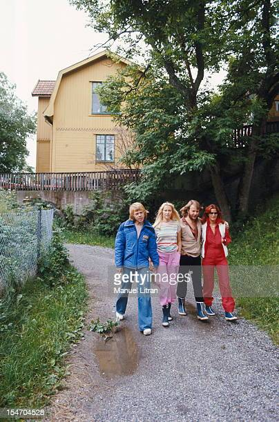The ABBA walking on a path with AnniFrid Lyngstad and her husband Benny Andersson Agnetha Faltskog and Bjorn Ulvaeus her husband
