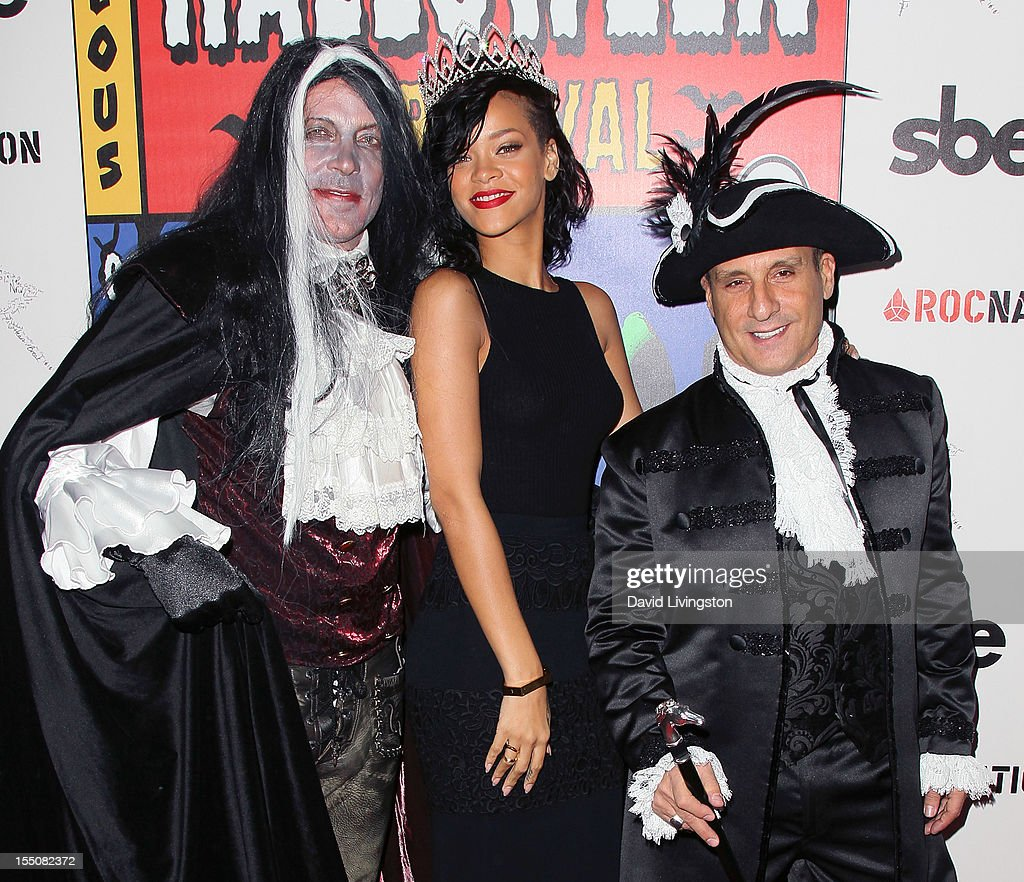 The Abbey's David Cooley, recording artist <a gi-track='captionPersonalityLinkClicked' href=/galleries/search?phrase=Rihanna&family=editorial&specificpeople=453439 ng-click='$event.stopPropagation()'>Rihanna</a> and guest attend <a gi-track='captionPersonalityLinkClicked' href=/galleries/search?phrase=Rihanna&family=editorial&specificpeople=453439 ng-click='$event.stopPropagation()'>Rihanna</a>'s naming as the Queen of the West Hollywood Halloween Carnaval by the City of West Hollywood in celebration of Halloween 2012 at Greystone Manor Supperclub on October 31, 2012 in West Hollywood, California.