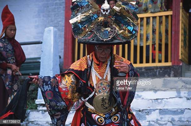 The abbot of Pemagantse monastery peforms at the annual Bumchu Masked Dance Festival in Sikkim Held immediately before the Tibetan Losar or New Year...