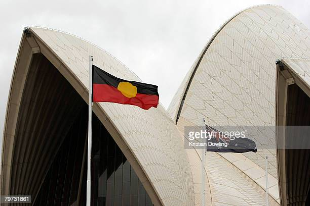 The Aboriginal and Australian flags are seen flying near the Sydney Opera House on the day Australian Prime Minister Kevin Rudd delivered an apology...