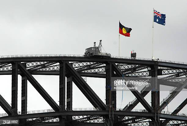 The Aboriginal and Australian flags are seen flying on the Sydney Harbour Bridge on the day Australian Prime Minister Kevin Rudd delivered an apology...