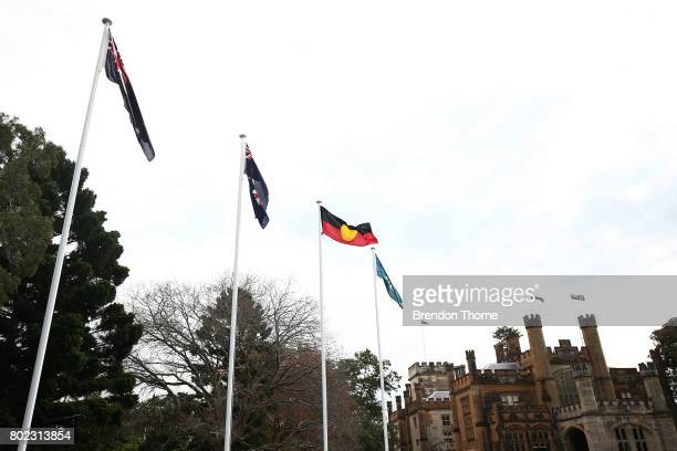 The Aboriginal and Torres Strait Island flags are unfurled at Government House on June 28 2017 in Sydney Australia The flags will fly permanently...