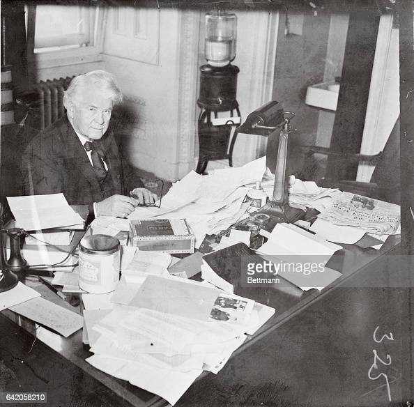 The above photo shows Henry T Rainey of Illinois the new speaker of the House as he was caught by the camera while clearing up his desk which is...