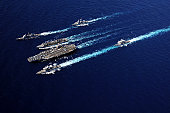 Pacific Ocean, September 19, 2010 09/14/2009 The Abraham Lincoln Carrier Strike Group ships cruise in formation during an underway replenishment with the Military Sealift Command fast combat support s