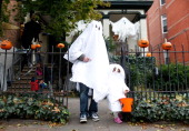The Abrahms family of Fort Greene Brooklyn 'trick or treat' as Brooklyn residents participate in Halloween activities on October 31 2012 in New York...
