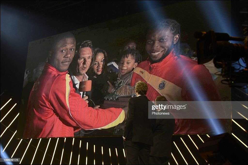 The absent Dieumerci Mbokani appears on a screen after winning the 59th edition of the Golden Shoe Award ceremony at theVTM studios on Janaury 23, 2013 in Vilvoorde, Belgium. The Golden Shoe (Gouden Schoen/Soulier d'Or) was awarded for the best soccer player of the Belgian Jupiler Pro League during the year 2012.