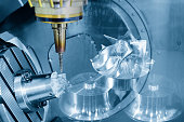 The abstract scene of  5-axis CNC Machining center cutting the turbine  part.The Aerospace part manufacturing.