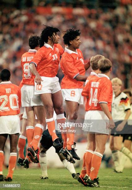 The AC Milan contingent of Ruud Gullit Frank Rijkaard and Marco van Basten of Netherlands line up to defend a free kick during the UEFA European...