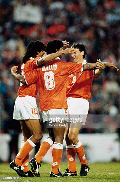 The AC Milan contingent of Ruud Gullit Frank Rijkaard and Marco van Basten of Netherlands celebrate a famous victory at full time during the UEFA...
