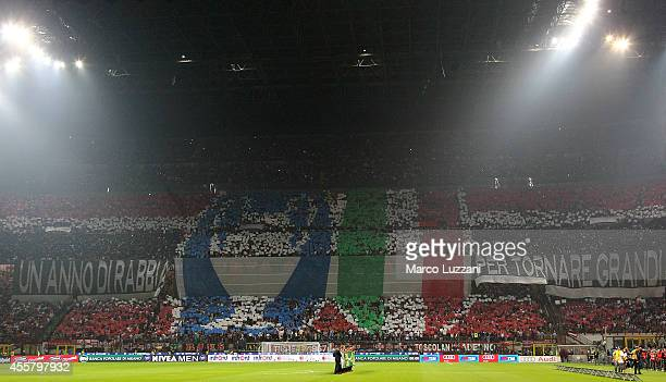 The AC Milan fans show their support before the Serie A match between AC Milan and Juventus FC at Stadio Giuseppe Meazza on September 20 2014 in...