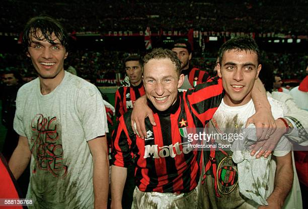 The AC Milan team celebrate after winning the Serie A League Championship in Milan circa May 1994 Identified are Paolo Maldini and JeanPierre Papin