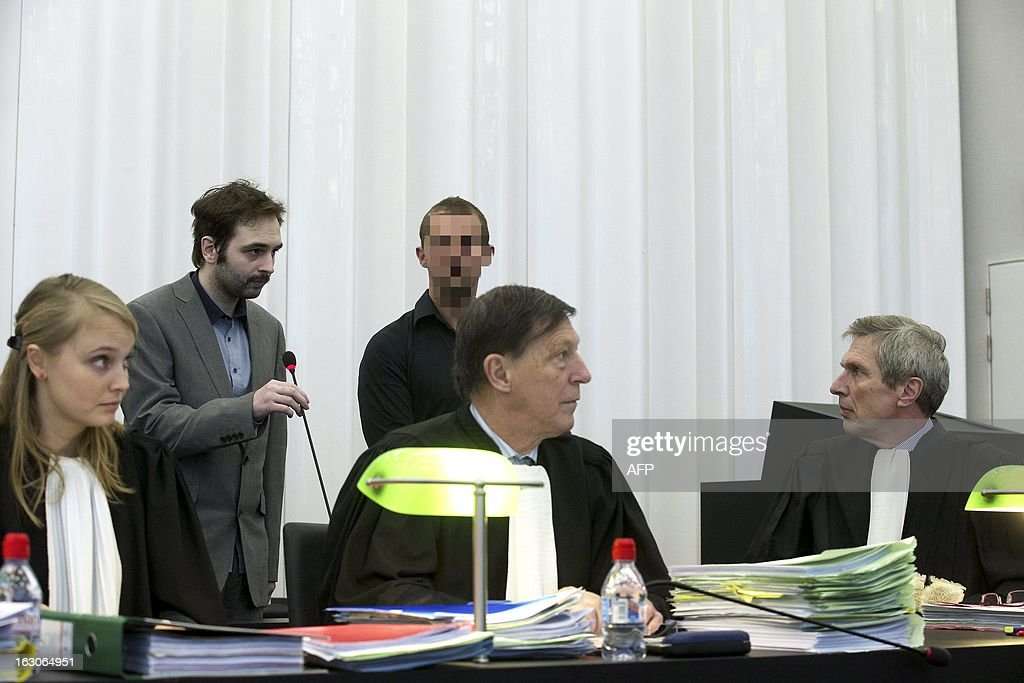 The accused Kim De Gelder (2nd L), who agreed to show his face for the first time, is pictured on the seventh day of his trial at the Gent justice palace on March 4, 2013. De Gelder, now 24, is charged with killing the two infants aged six and nine months and their 54-year-old carer in an attack on the Fable Land nursery in the town of Dendermonde in January 2009, as well as the attempted murder of 22 others at the creche -- including 16 babies and toddlers. The court must determine whether De Gelder can be considered sane or not.