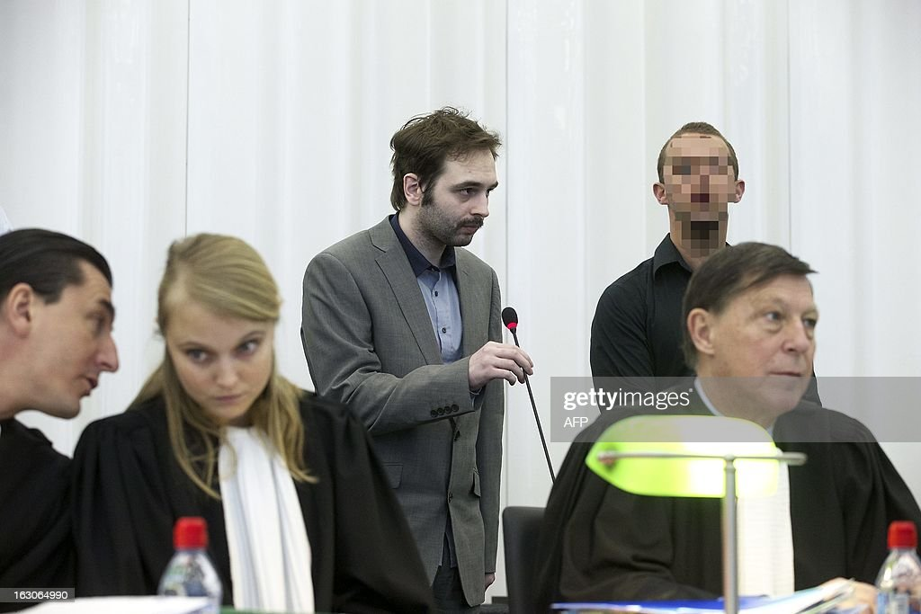 The accused Kim De Gelder (C), who agreed to show his face for the first time, is pictured on the seventh day of his trial at the Gent justice palace on March 4, 2013. De Gelder, now 24, is charged with killing the two infants aged six and nine months and their 54-year-old carer in an attack on the Fable Land nursery in the town of Dendermonde in January 2009, as well as the attempted murder of 22 others at the creche -- including 16 babies and toddlers. The court must determine whether De Gelder can be considered sane or not.