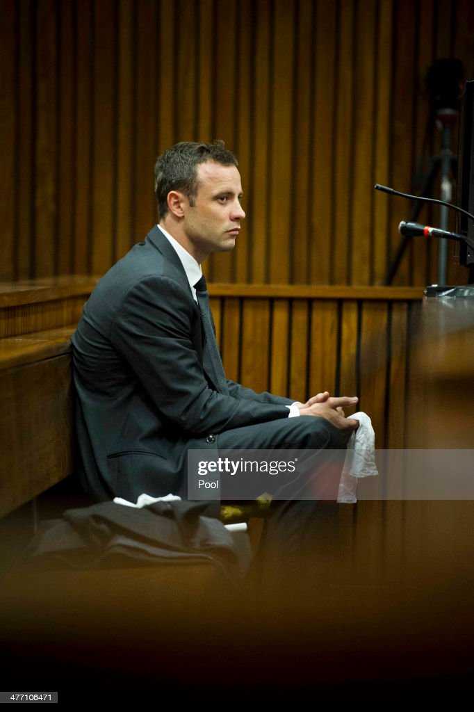 The accused weeps at the Pretoria High Court on March 7, 2014, in Pretoria, South Africa. Pistorius, stands accused of the murder of his girlfriend, Reeva Steenkamp, on February 14, 2014. This is Pistorius' official trial, the result of which will determine the paralympian athlete's fate.