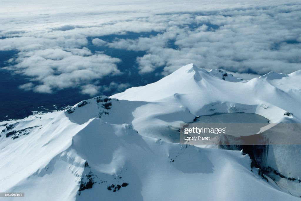 The acidic crater lake at the top of Mt Ruapehu on the North Island of New Zealand. The volcano has erupted about 50 times since 1861 : Stock Photo
