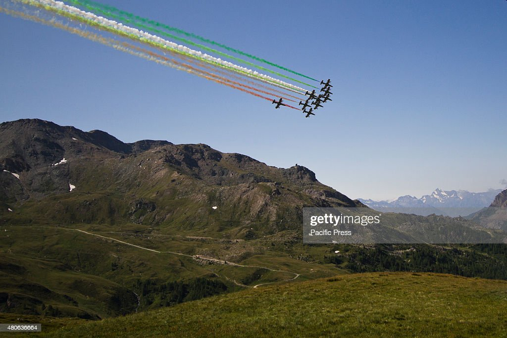 The acrobatic team 'Frecce Tricolori' of the Italian Air Force draws the Italian flag with smoke trails flying over BreuilCervinia The event...
