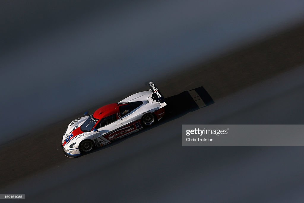 The #5 Action Express Racing Corvette DP driven by Brian Frisselle, Nelson Piquet Jr, Felipe Nasr, Christian Fittipaldi and Joao Barbosa, drives during the Rolex 24 at Daytona International Speedway on January 27, 2013 in Daytona Beach, Florida.