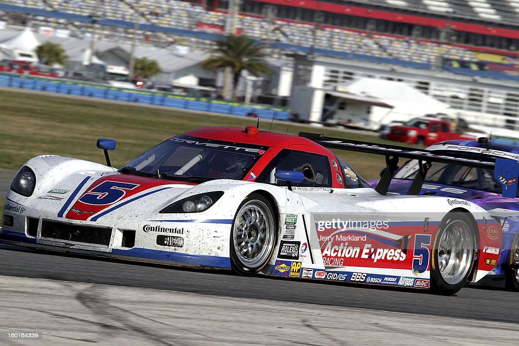 The #5 Action Express Racing Corvette DP driven by Brian Frisselle, Nelson Piquet Jr., Felipe Nasr, Christian Fittipaldi and Joao Barbosa drives the Rolex 24 at Daytona International Speedway on January 27, 2013 in Daytona Beach, Florida.
