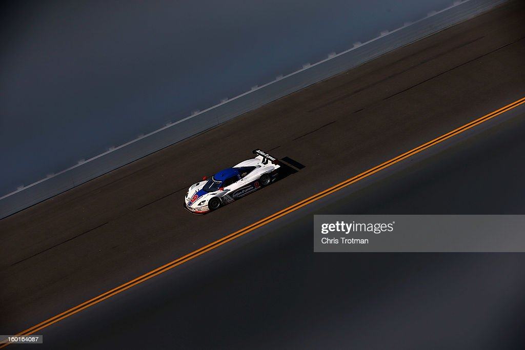 The #9 Action Express Racing Corvette DP driven by Mike Rockenfeller, Burt Frisselle, Christian Fittipaldi and Joao Barbosa, drives during the Rolex 24 at Daytona International Speedway on January 27, 2013 in Daytona Beach, Florida.