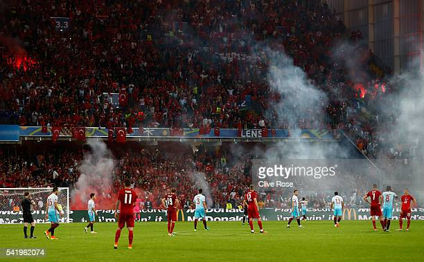 The action is stopped with flares on the pitch during the UEFA EURO 2016 Group D match between Czech Republic and Turkey at Stade BollaertDelelis on...