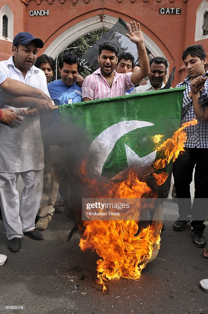 The activist of Congress party burning the Pakistani flag during against demonstrating against the deadly attack on Indian prisoner Sarabjit Singh in Pakistani Jail, on April 27, 2013 in Amritsar, India. Sarabjit's family going to apply Pakistani Visa to meet Sarabjit in Pakistani hospital. According to the source, Sarabjit was hit on the head with bricks and his neck and stomach were cut with blades. Sarabjit was admitted to the state-run Jinnah Hospital with a severe head injury on Friday evening. Sarabjit was convicted for alleged involvement in a string of bomb attacks in Punjab province that killed 14 people in 1990.
