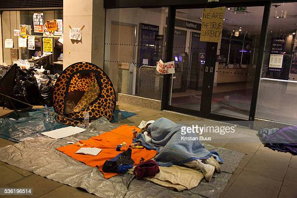 The activist volunteer medic asleep in fornt of his first aid station outside the Natwest bank in St Paul's SquareThe London Stock Exchange was...