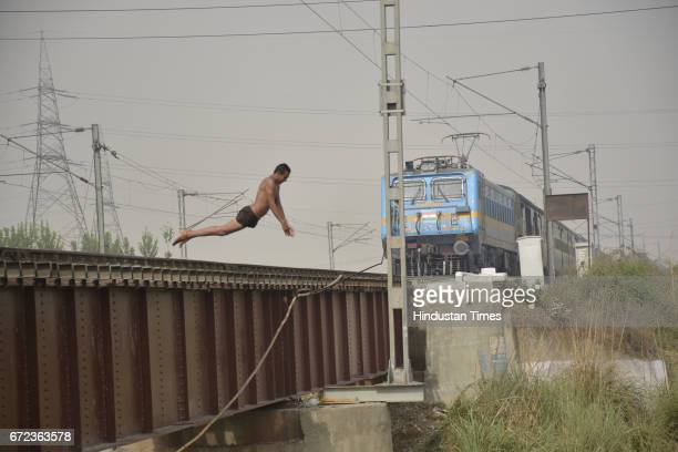 The activity of youngsters jumping ahead of fast moving train have surfaced yet again over railway bridge at Upper Ganga Canal masuri river on April...
