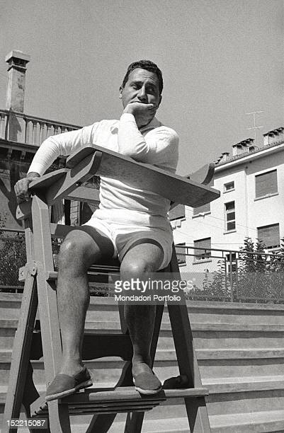 The actor Alberto Sordi makes a pretence of being umpire sitting on the chair of the competition director during the 17th Venice Intenational Film...
