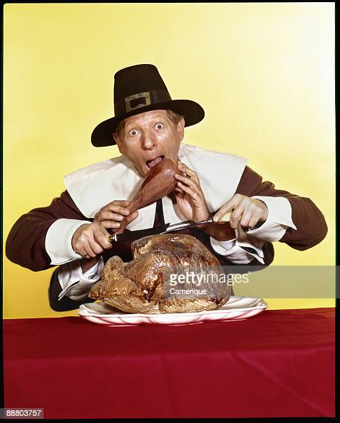 The actor and comedian Danny Kaye acts out a Thanksgiving comedy scene while dressed as an American pilgrim ca 1965 His character has multiple hands...