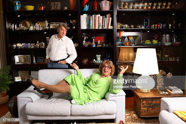 'The actor and TV presenter Marco Columbro looking at himself dressed as Tootsie during a photo shooting at home Basiglio Italy 20th October 2006 '