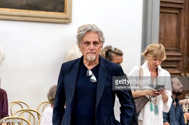 The actor Andrea Roncato in front the coffin of Italian actor Paolo Villaggio lying in repose at Rome's city hall on July 5 2017 in Rome Italy Paolo...