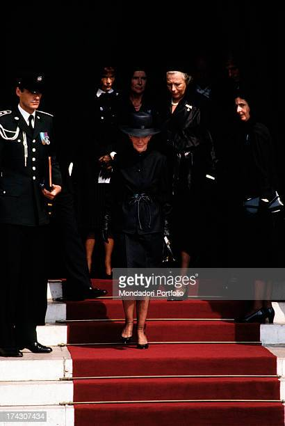 The actor Cary Grant good friend of Grace Kelly goes down the stairs of the Cathedral of Monaco after the celebration of the funeral mass in honour...