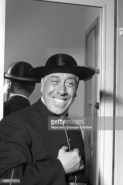 The actor Fernandel smiling in cassock during a break on the set of the film Don Camillo's Last Round 1955