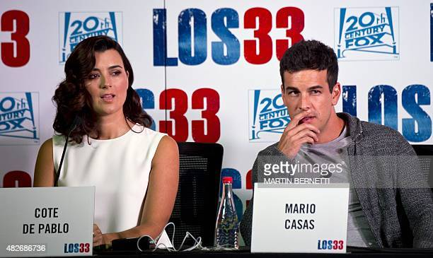 The actors of the film 'The 33' Cote de Pablo and Mario Casas pose for the photographers in Santiago on August 1 on the eve of the avant premiere of...