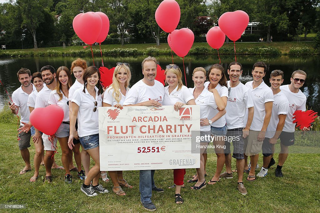 The actors of the TV soap 'Verbotene Liebe' attend the Charity Event Benefitting Flood Victims on July 20, 2013 in Grafenau, Germany.