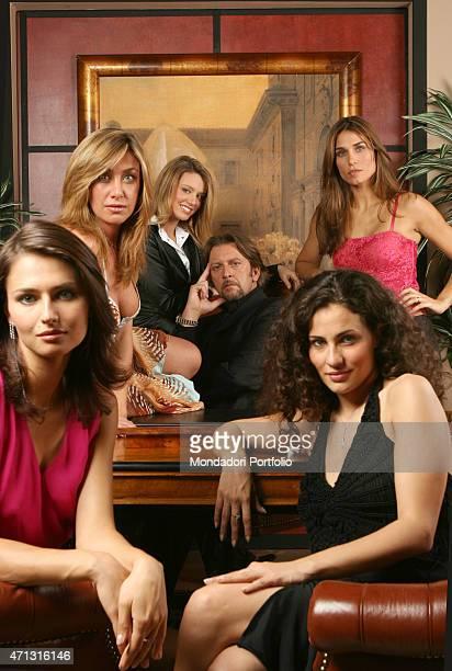 The actors Sergio Troiano Elena Barolo and Mirca Viola posing for a photo shooting on the set of the soap opera CentoVetrine San Giusto Canavese...