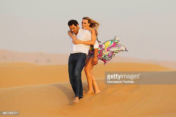 The actress and singer Serena Autieri and her future husband Enrico Griselli during a photo shooting on the dunes of the nature reserve of the Maha...