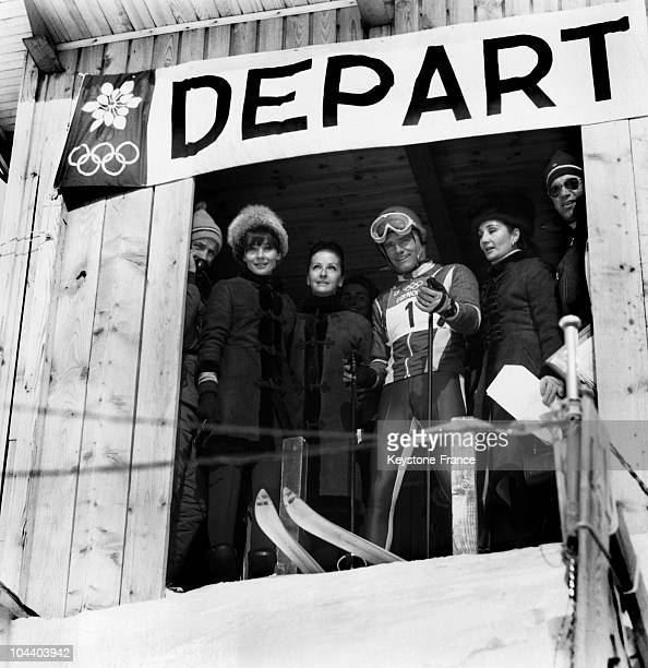The actress Audrey HEPBURN the Countess of RIBES and Mrs Yul BRYNNER watching French skier JeanClaude KILLY taking off at the 1968 Winter Olympics in...