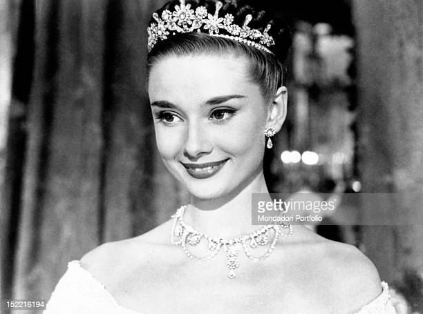 The actress Audrey Hepburn wearing a tiara is the beautiful Princess Ann in the movie Roman Holiday Rome 1953